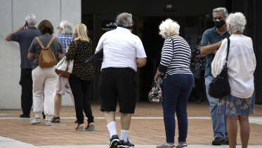 Voters queue to cast their ballots early in Miami, Florida.