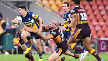 Moses makes a break during the round three NRL match against the Brisbane Broncos in 2020.