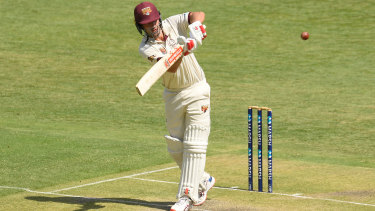 Joe Burns of Queensland bats during the Marsh Sheffield Shield match against the Tasmanian Tigers at the Gabba on Friday.