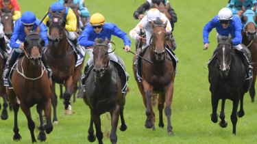 1-2-3: Kiamichi (yellow cap) leads home Microphone (blue cap) and Lyre (white cap)  in a Godolphin  Slipper trifecta.