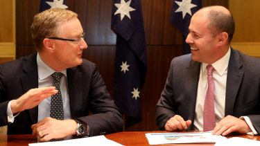 "In ""100 per cent agreement"" ... RBA governor Philip Lowe with Treasurer Josh Frydenberg after their two-hour meeting on the state of the economy."
