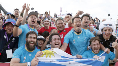 Triumphant Uruguayan players celebrate with the crowd after their stunning defeat of Fiji.