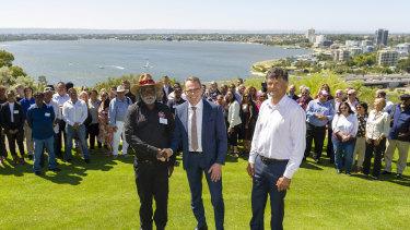 Foreground left-to-right, Muuki Taylor (Martu Elder), BHP chief executive Andrew Mackenzie and Richard Walley (Noongar Elder).