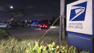 Postal service police screen employees entering the Royal Palm processing and Distribution Centre in Opa-locka, Florida.
