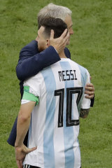 Lionel Messi is comforted by France head coach Didier Deschamps.
