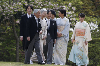 Former emperor Akihito, second from left, with Michiko, third from left,  Naruhito, fourth from left, Masako, second from right, Prince Akishino, Princess Kiko, third from right, and their daughter Princess Mako at a palace garden party in Tokyo in 2017.