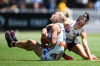 Jumper clash: Adelaide and St Kilda were both wearing predominantly white strips on Sunday.