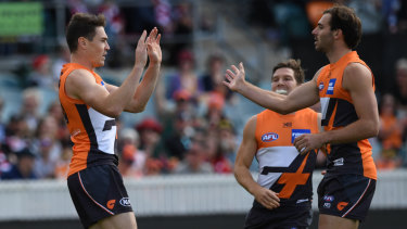 Jeremy Cameron (left) boots another goal for the Giants.