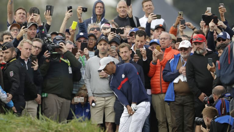 Tiger Woods chips on to the sixth green during a fourball match on the opening day of the 42nd Ryder Cup at Le Golf National in Saint-Quentin-en-Yvelines, outside Paris.