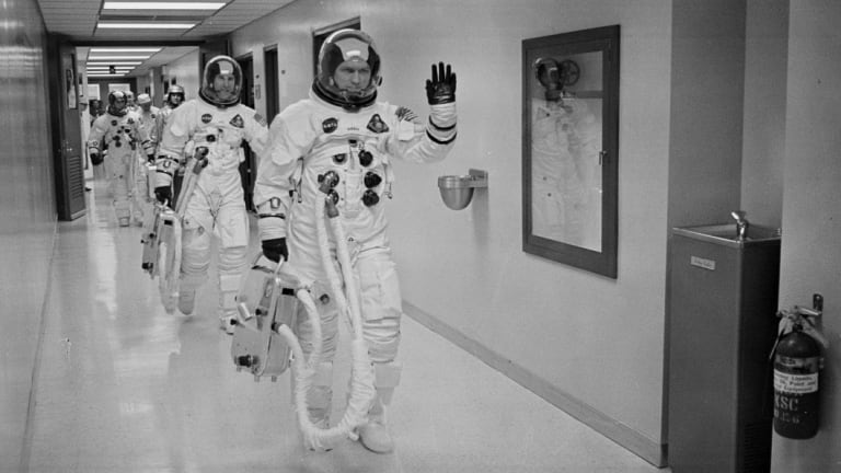 Commander Col. Frank Borman leads the way to the launch pad at the Kennedy Space Center in Florida.