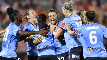 Triumphant: Sofia Huerta is mobbed after scoring the winner for Sydney FC.