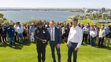Foreground left-to-right, Muuki Taylor (Martu Elder), BHP chief executive Andrew Mackenzie and Richard Walley (Noongar Elder).
