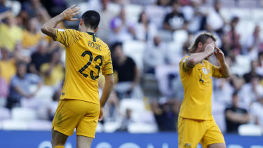 Off night: Australia's Tom Rogic, left, and teammate Ryan Grant lament a missed chance.