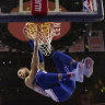Ben Simmons dunks en route to the 76ers' win.