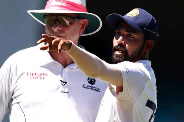 India's Mohammed Siraj stops play during last week's cricket Test at the SCG to make a complaint to umpire Paul Reiffel about spectators.