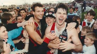 Danny Frawley (right) with Stewart Loewe after beating Fitzroy by one point at Moorabbin in 1990.