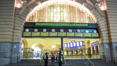 Flinders Street Station clocks just after 8pm on 2 August as Melbourne's curfew came into effect.