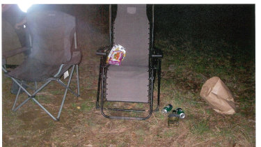 The couple's abandoned camp chairs, beer cans and Pizza Shapes.