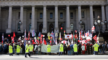 The 150th anniversary of the Eight Hour Day is celebrated on the steps of Parliament House in Melbourne in 2006.