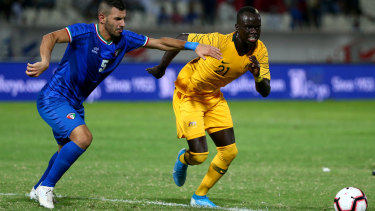 Awer Mabil of Australia and Fahad Alhajeri of Kuwait in action.