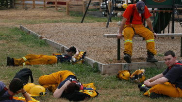 Firefighters take a break at Arthur's Creek.