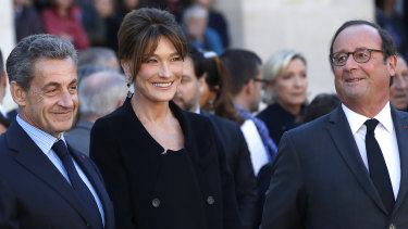 Former French presidents Nicolas Sarkozy, left, and Francois Hollande, with Sarkozy's wife Carla Bruni last year.