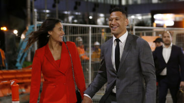 Israel Folau leaves a hearing with wife Maria after agreeing to a deal with Rugby Australia.