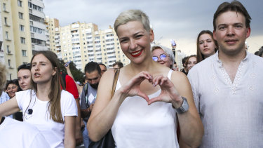 Detained: Maria Kolesnikova, one of Belarus' opposition leaders, centre, during a rally in Minsk, Belarus, last month.
