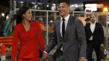 $3.6 million smile: Folau leaves last week's hearing with wife Maria after agreeing a deal with Rugby Australia.