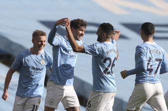 John Stones (second from left) celebrates after scoring for City.