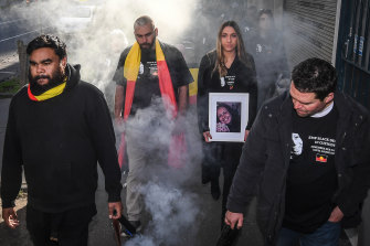 Tanya Day's family and supporters take part in a smoking ceremony before the 2019 coronial inquest into her death.