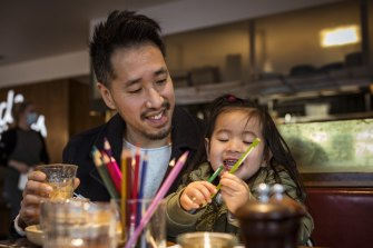 Christopher Ong and daughter Ava, 3, enjoy a coffee at Northcote cafe Bicycle Thieves as Melbourne emerges from its latest lockdown.
