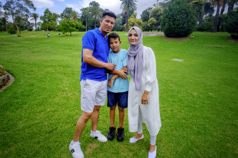 Zeynab Mohseni, right, with husband Asif Rezai and their son Biniamin at Footscray Park on Australia Day.