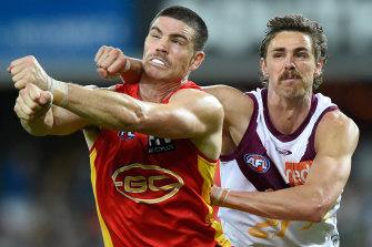 Spoilt day: Joe Daniher tries to spoil Gold Coast's Sam Collins.