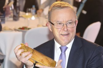 Federal Opposition Leader Anthony Albanese holds a 400 troy ounce gold bar during the minerals week luncheon at the Hyatt Hotel in Canberra on Wednesday.