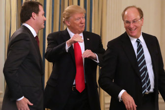 BlackRock chief Larry Fink (right) with US President Donald Trump and Wal-Mart chief Doug McMillon at the White House in 2017.