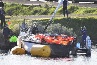 Police at a pier in North Geelong where to bodies were found on a burnt out yacht.