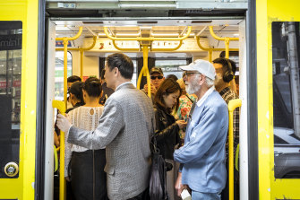 Commuters pack into a crowded tram along Bourke Street during the lunchtime break earlier this year.
