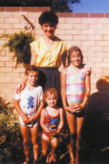Pauline Hanson in the front yard of the family home in Ipswich with three of her children: Adam, Lee and Amanda.