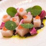 Raw Hiramasa kingfish, tamari onions, nasturtium and rice vinegar at Lee Ho Fook.