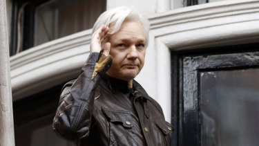 WikiLeaks founder Julian Assange greets supporters from a balcony of the Ecuadorian embassy in London in June, 2017.