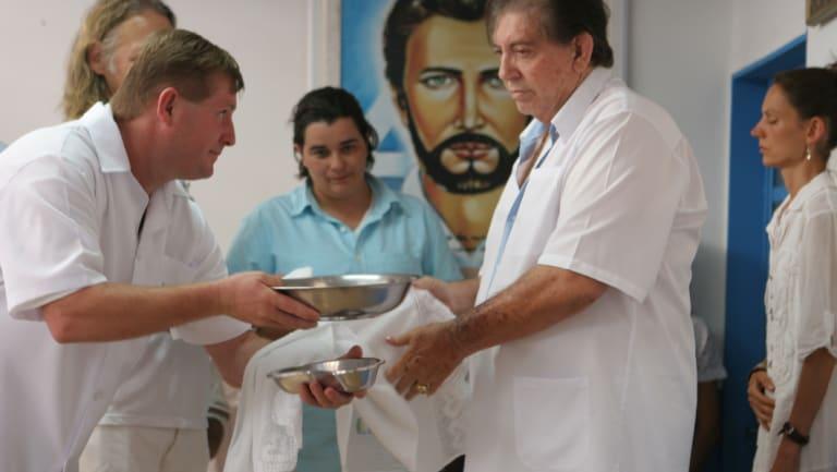 John of God, right, in his practice in Brazil in 2014.