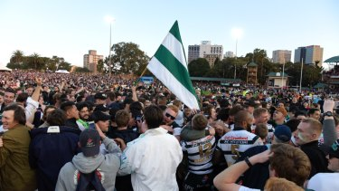 History: Warringah supporters swarm North Sydney Oval after club's first Shute Shield win in 12 years.