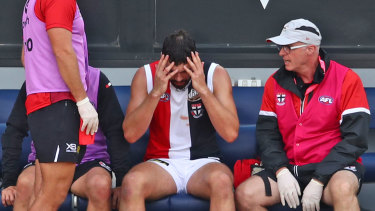 Saint scare: Paddy McCartin's pre-season comes to a worrying end with another knock to the head.