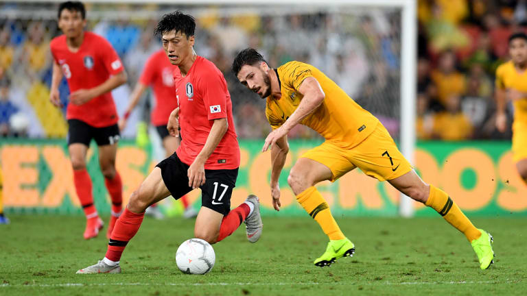 Dispossessed: Mathew Leckie chases Lee Chungyong.