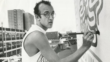 New York graffiti artist Keith Haring painting his mural on the wall of the Collingwood Technical School in Johnston Street in 1984.
