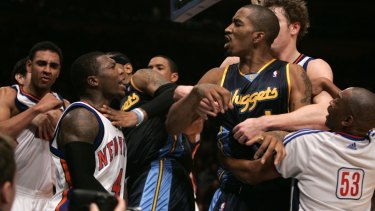 New York's Nate Robinson and Denver's J.R. Smith clash.