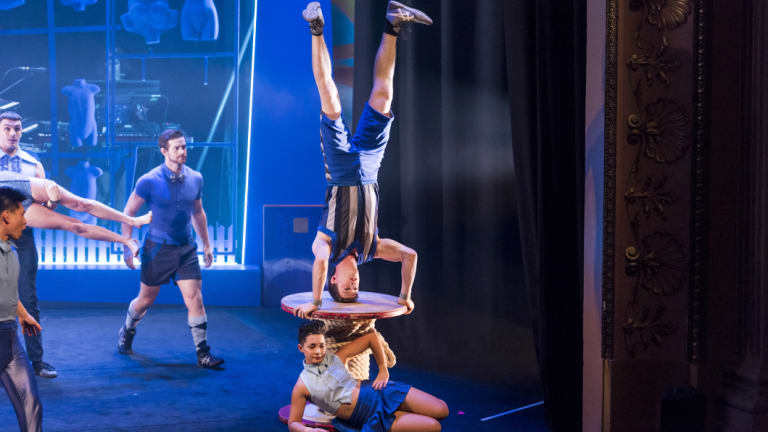 Lachlan Sukroo (upside down) and other cast members of <i>Model Citizens</i> by Circus Oz.