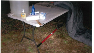 Mr Woodford's tomahawk and shovel at the couple's camp table.