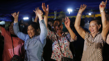 Thais celebrate after the final evacuation from Tham Luang is announced.